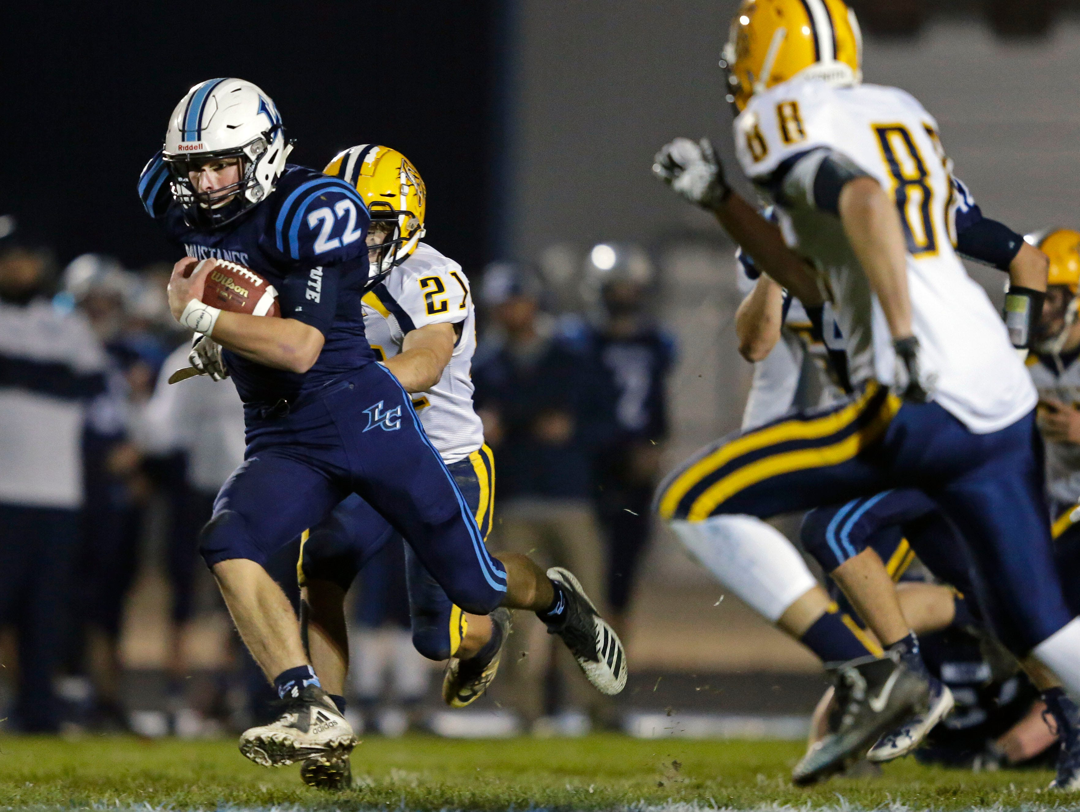 Bryce Schumacher of Little Chute carries the ball against Chilton in a WIAA Division 4 second round football playoff game Friday, October 26, 2018, at Little Chute High School in Little Chute, Wis.Ron Page/USA TODAY NETWORK-Wisconsin