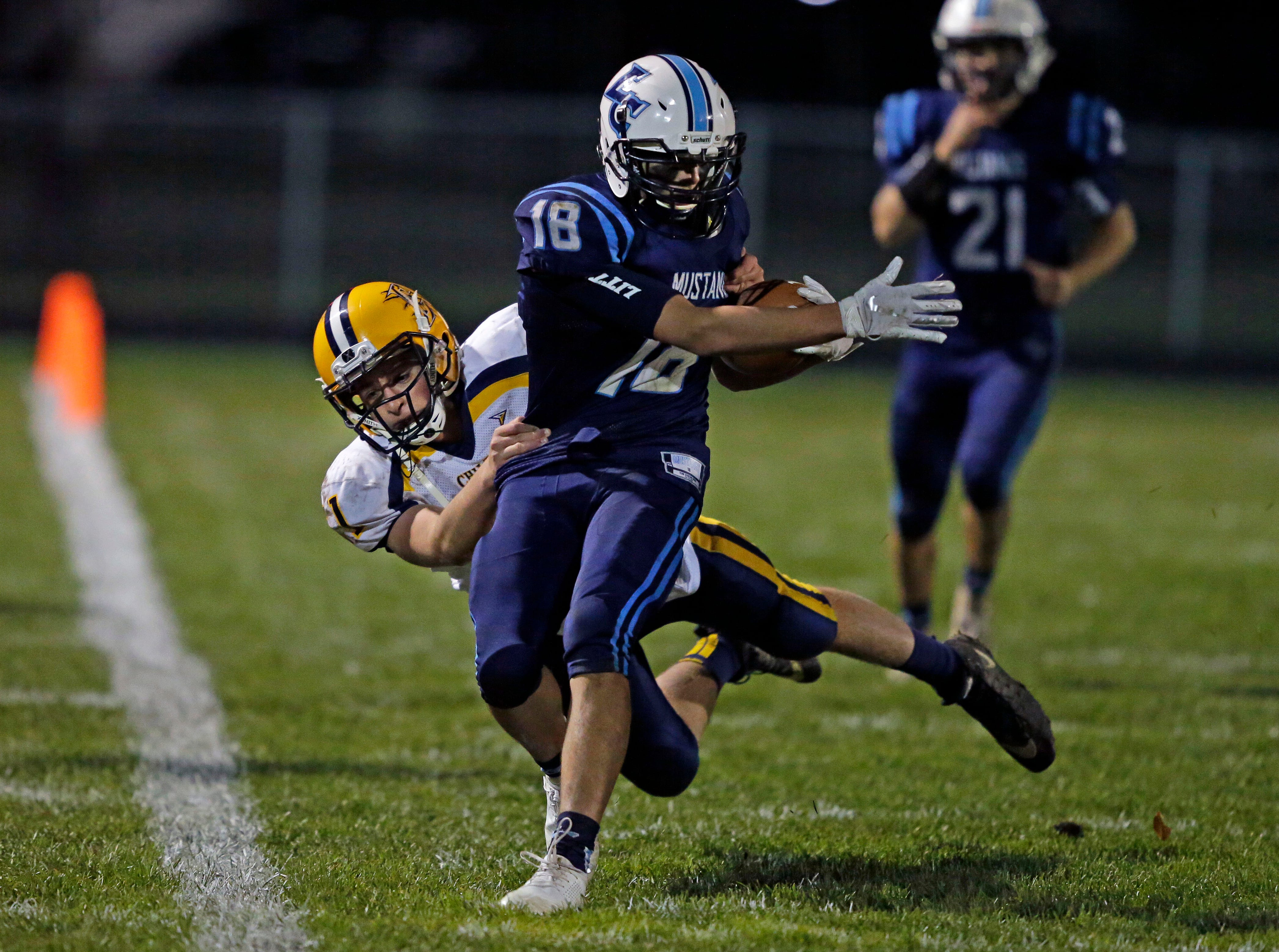 David Peeters of Little Chute intercepts a pass and is tackled by Fredric Lamers of Chilton in a WIAA Division 4 second round football playoff game Friday, October 26, 2018, at Little Chute High School in Little Chute, Wis.Ron Page/USA TODAY NETWORK-Wisconsin