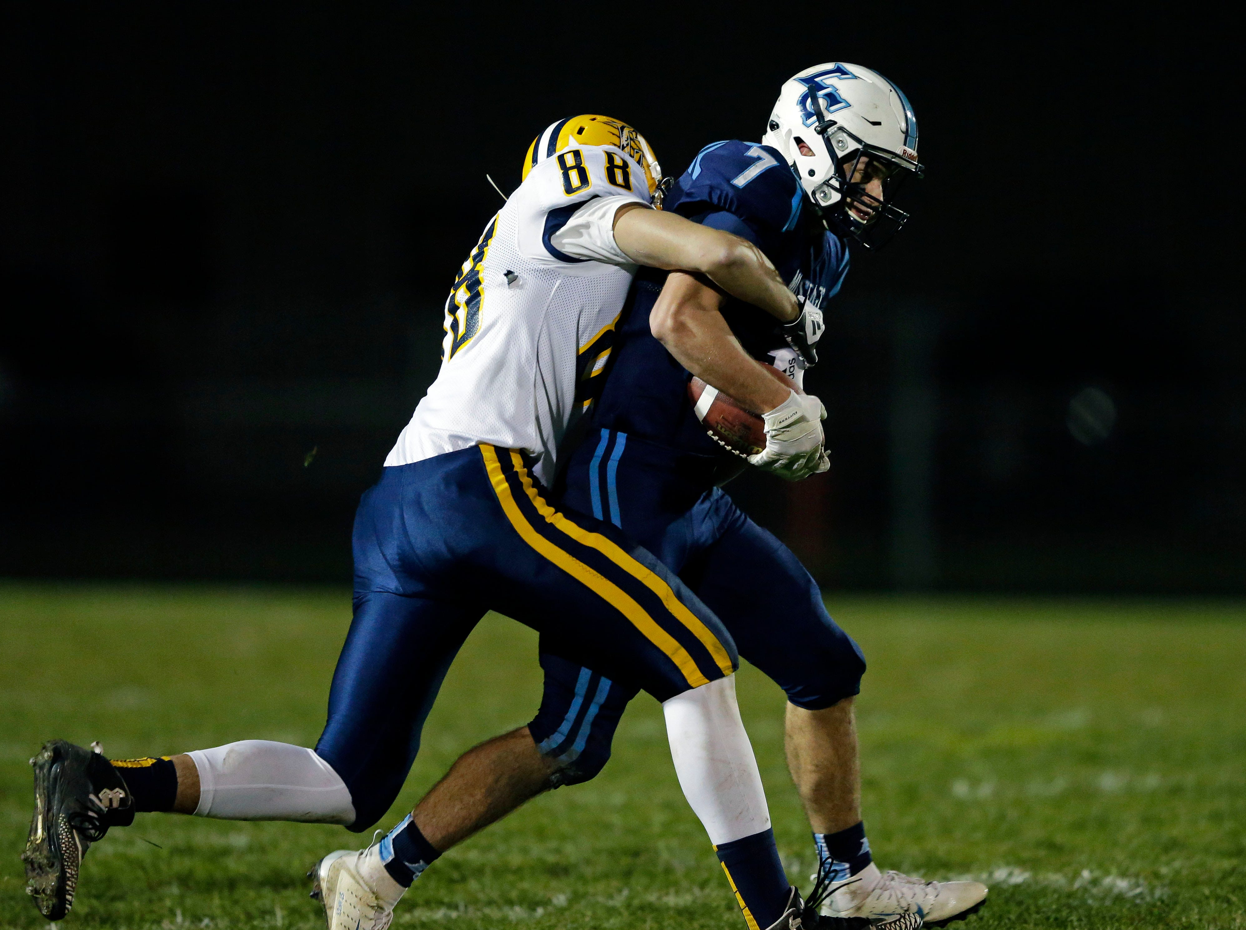 Adam Hietpas of of Little Chute is tackled by Ryan Broeckel of Chilton in a WIAA Division 4 second round football playoff game Friday, October 26, 2018, at Little Chute High School in Little Chute, Wis.Ron Page/USA TODAY NETWORK-Wisconsin