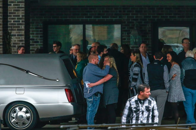 Mourners embrace each other as they leave the visitation of James and Denise Closs on Saturday at St. Peter Catholic Church in Cameron. The couple was found dead in their Barron home on Oct. 15, and their deaths have been ruled homicides. Their 13-year-old daughter, Jayme, remains missing and is considered endangered.
