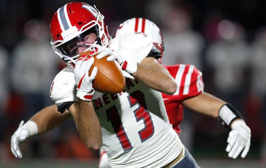 Neenah's Logan Morrow makes a catch against Kimberly during Friday's game in Kimberly.