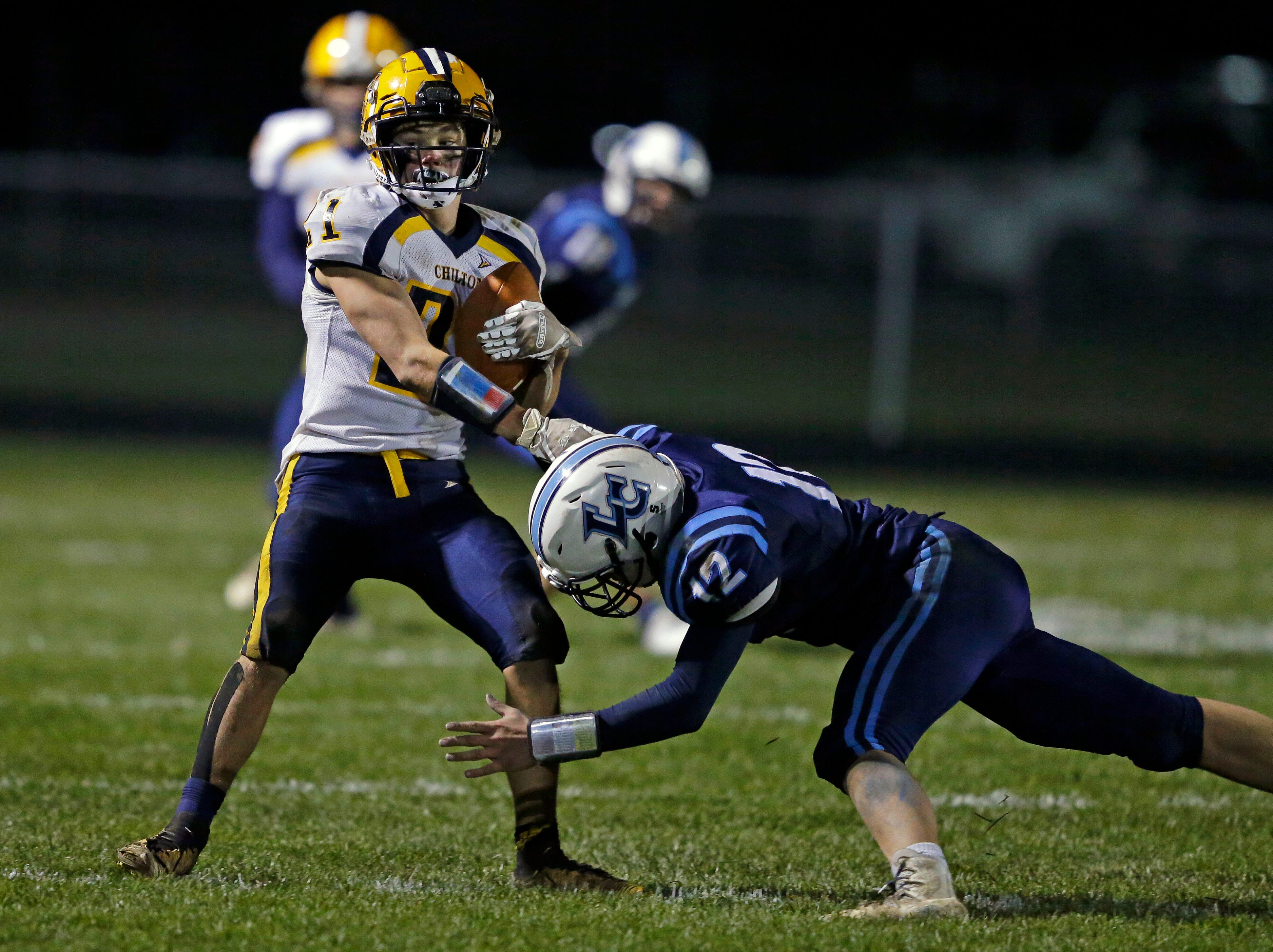 Gaven Lisowe of Chilton tries to spin away from Tate Huss of Little Chute in a WIAA Division 4 second round football playoff game Friday, October 26, 2018, at Little Chute High School in Little Chute, Wis.Ron Page/USA TODAY NETWORK-Wisconsin
