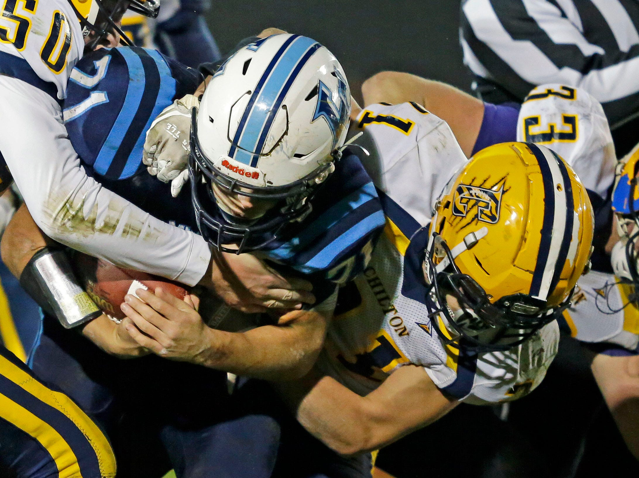 Isaac Van Deurzen of Little Chute is tackled by a trio of Chilton defenders in a WIAA Division 4 second round football playoff game Friday, October 26, 2018, at Little Chute High School in Little Chute, Wis.Ron Page/USA TODAY NETWORK-Wisconsin