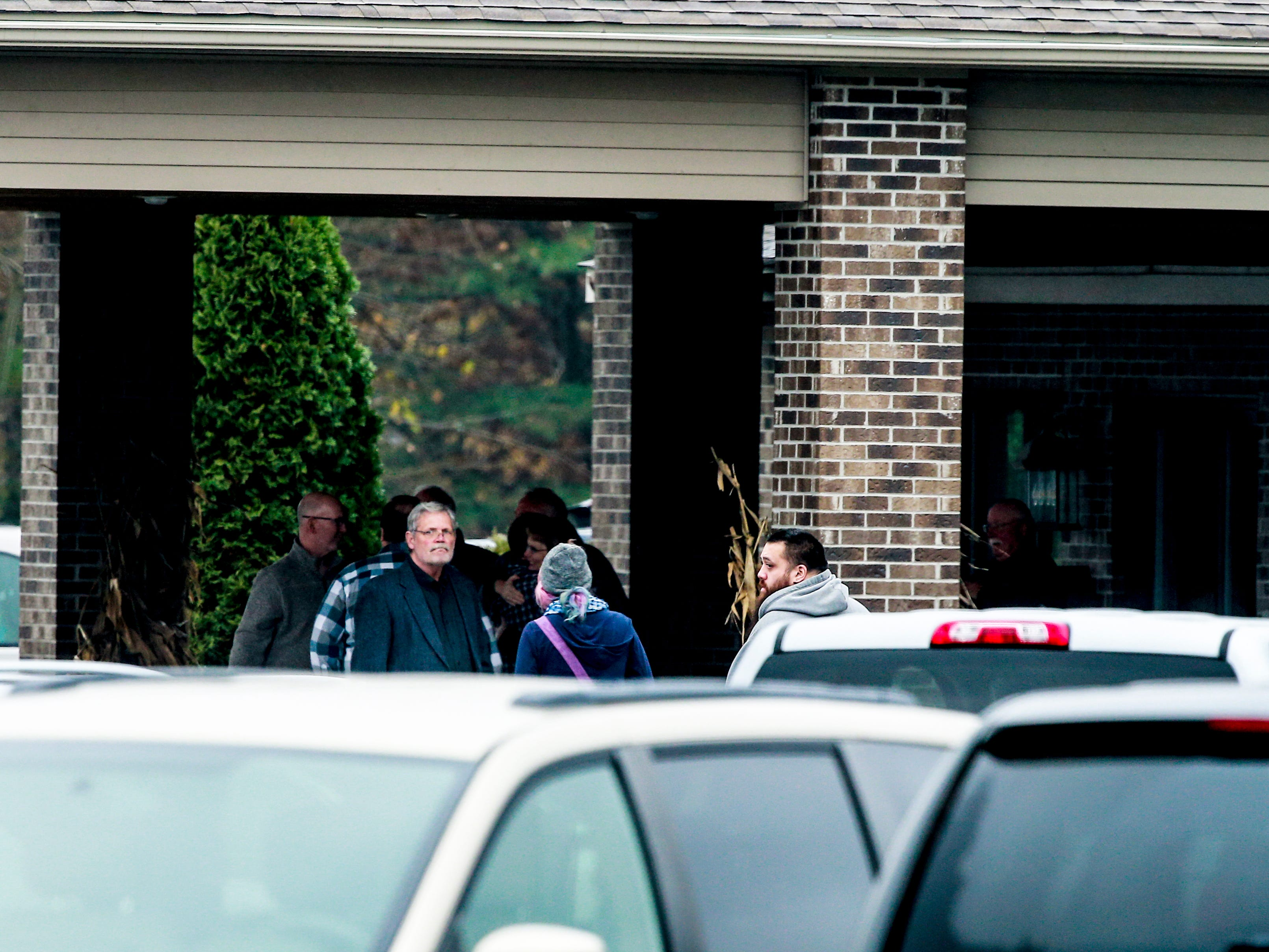 People attend the visitation of James and Denise Closs on Saturday at St. Peter Catholic Church in Cameron. Their deaths on Oct. 15 have been ruled homicides, and their 13-year-old daughter, Jayme, remains missing and endangered.