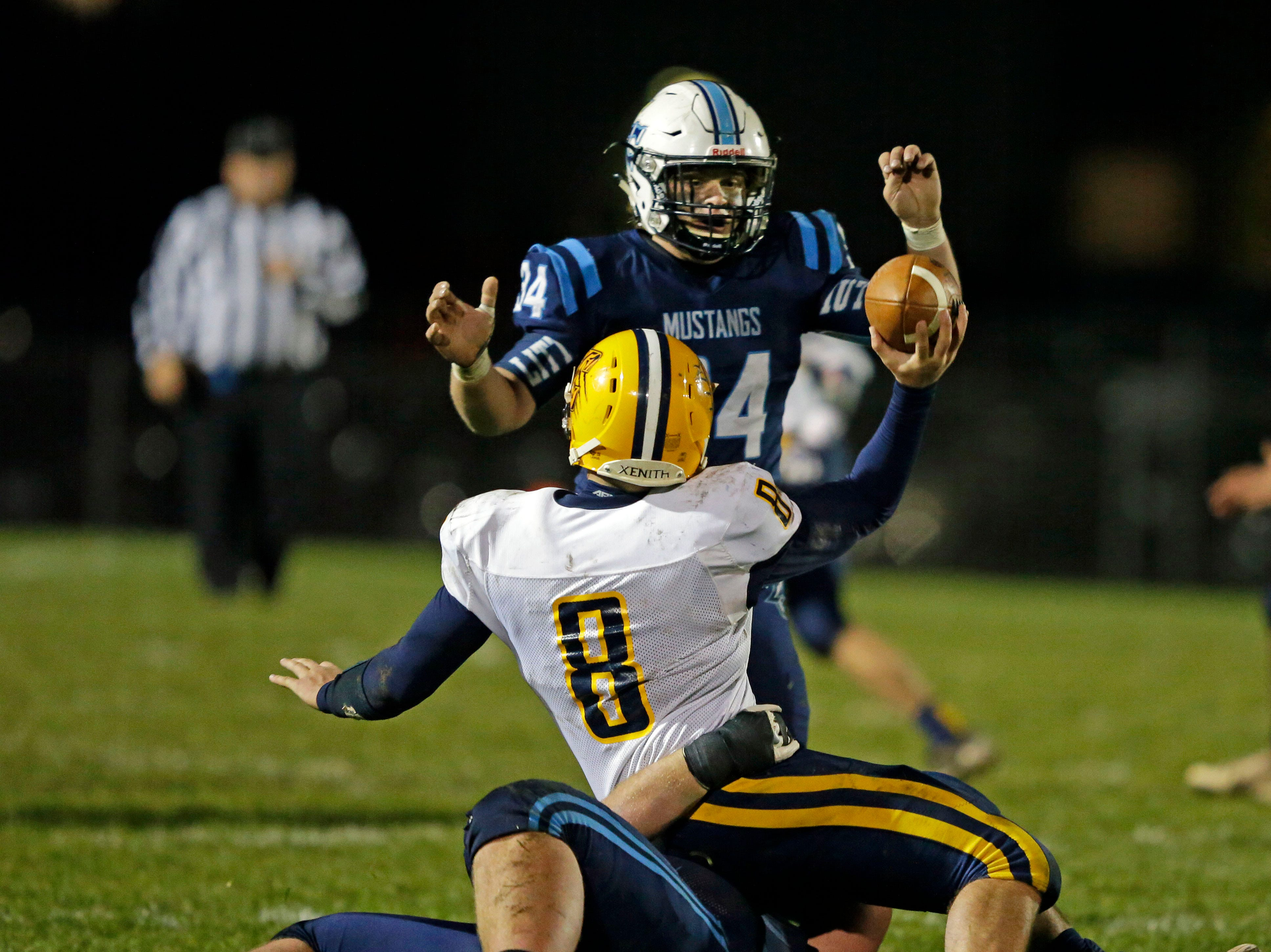 Nate Hietpas of Little Chute tackles Chilton quarterback Jake Criter as he tries to get a pass away in a WIAA Division 4 second round football playoff game Friday, October 26, 2018, at Little Chute High School in Little Chute, Wis.Ron Page/USA TODAY NETWORK-Wisconsin