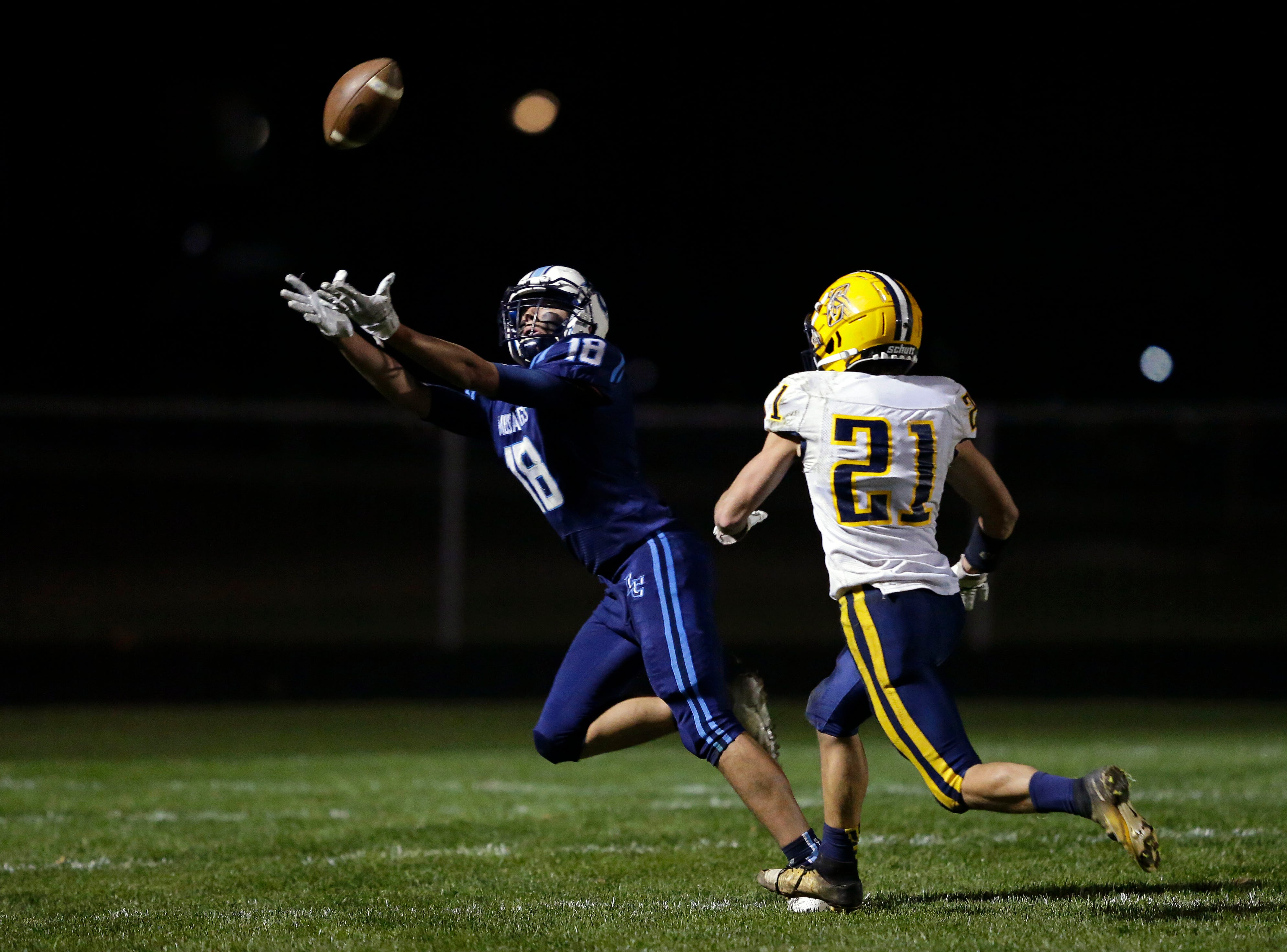 David Peeters of Little Chute tries for an interception against Chilton in a WIAA Division 4 second round football playoff game Friday, October 26, 2018, at Little Chute High School in Little Chute, Wis.Ron Page/USA TODAY NETWORK-Wisconsin
