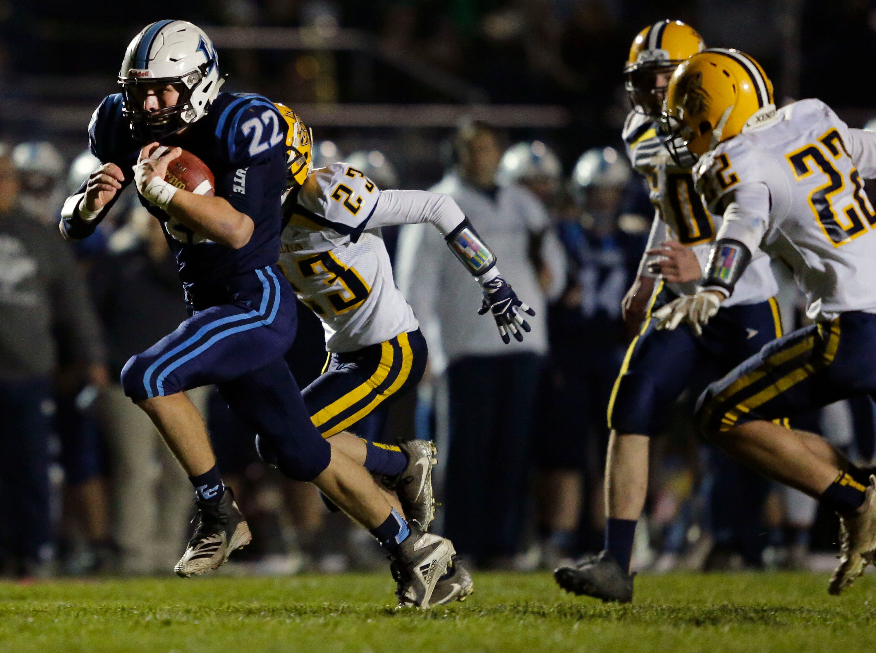 Bryce Schumacher of Little Chute breaks away from the defense for a touchdown against Chilton in a WIAA Division 4 second round football playoff game Friday, October 26, 2018, at Little Chute High School in Little Chute, Wis.Ron Page/USA TODAY NETWORK-Wisconsin
