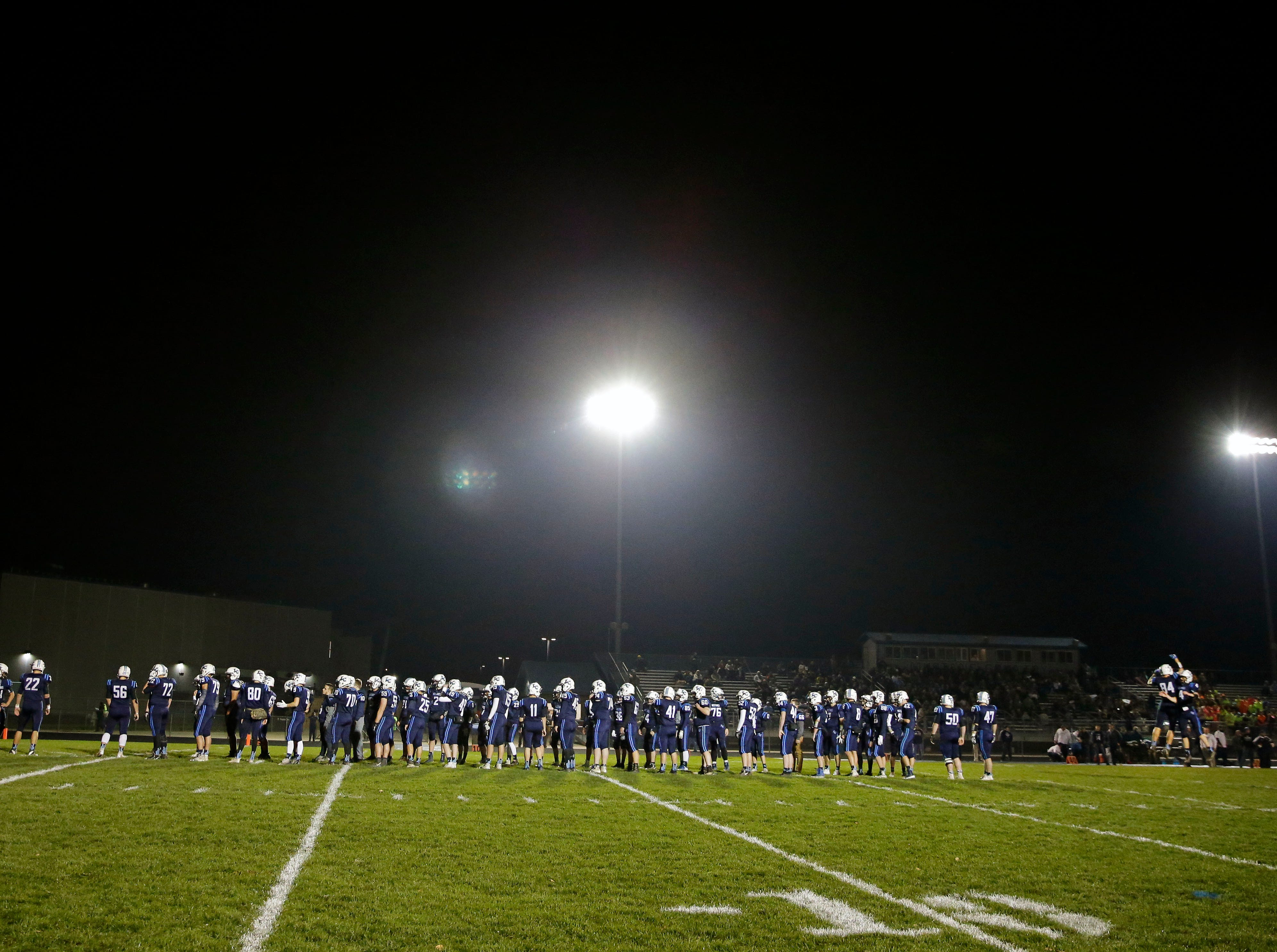 Little Chute players take the field against Chilton in a WIAA Division 4 second round football playoff game Friday, October 26, 2018, at Little Chute High School in Little Chute, Wis.Ron Page/USA TODAY NETWORK-Wisconsin