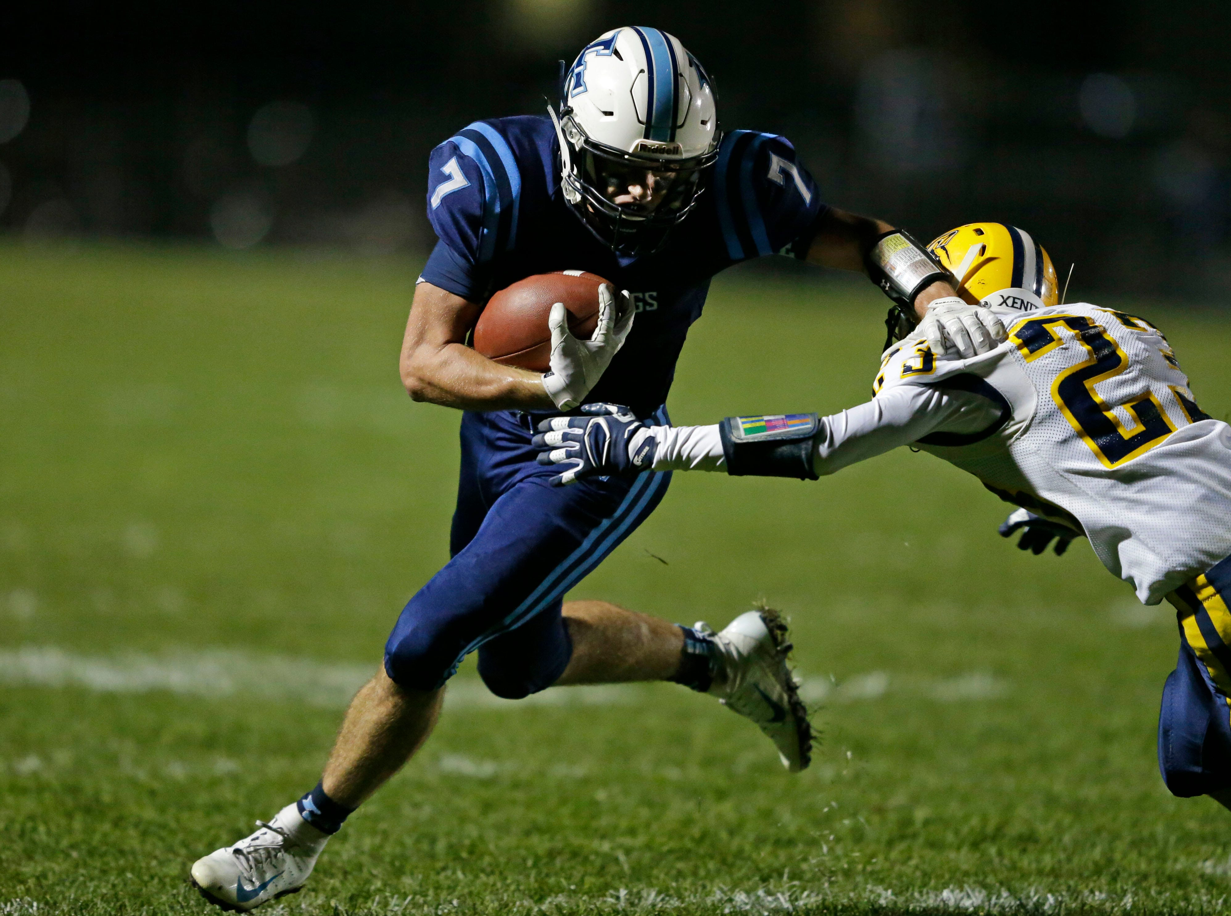 Adam Hietpas of Little Chute tries to get around Camden Bowe of Chilton in a WIAA Division 4 second round football playoff game Friday, October 26, 2018, at Little Chute High School in Little Chute, Wis.Ron Page/USA TODAY NETWORK-Wisconsin