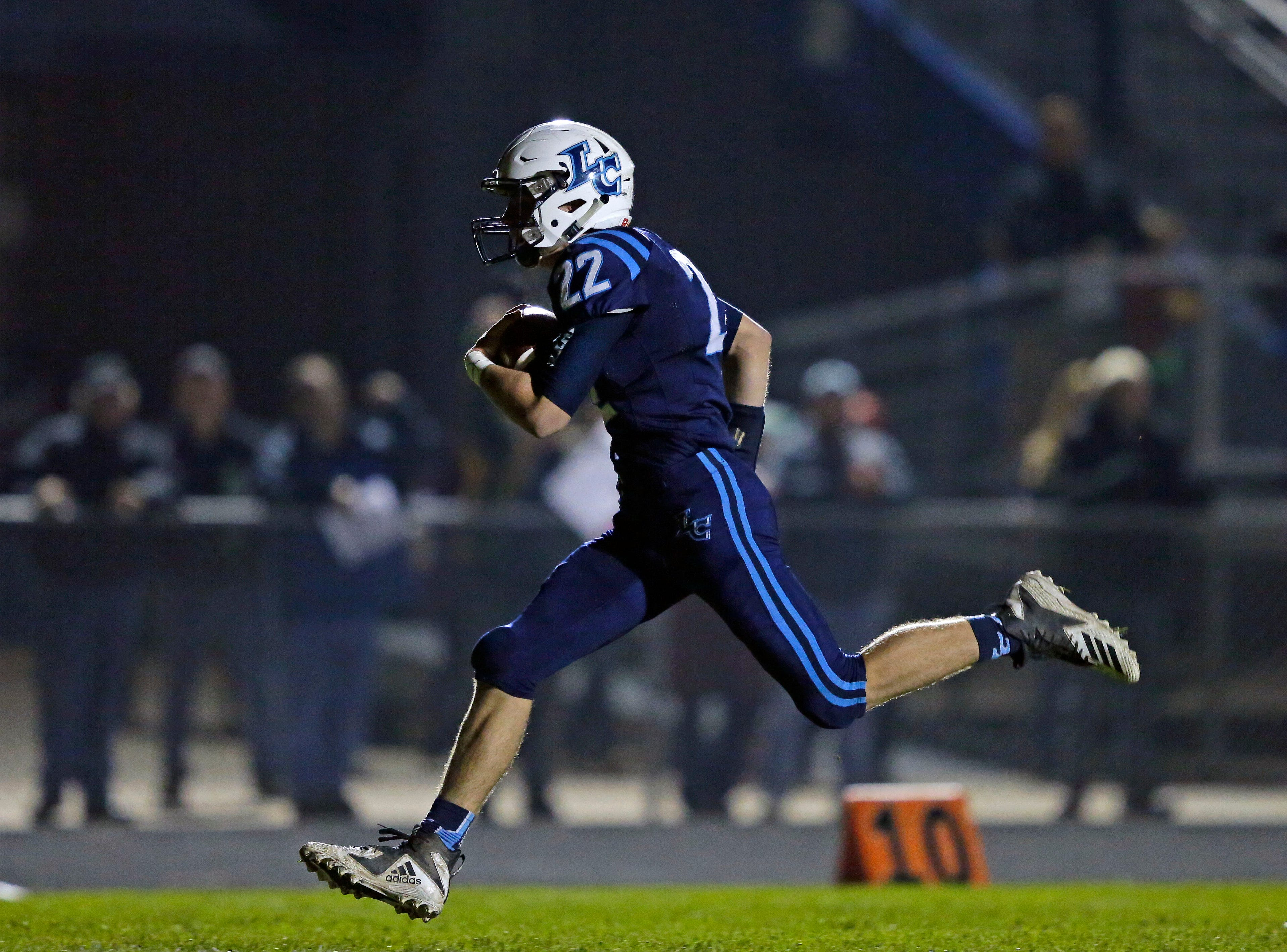 Bryce Schumacher of Little Chute rushes for a touchdown against Chilton in a WIAA Division 4 second round football playoff game Friday, October 26, 2018, at Little Chute High School in Little Chute, Wis.Ron Page/USA TODAY NETWORK-Wisconsin