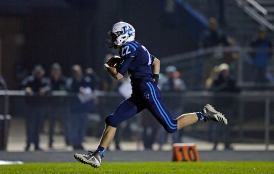 Bryce Schumacher of Little Chute rushes for a touchdown against Chilton.