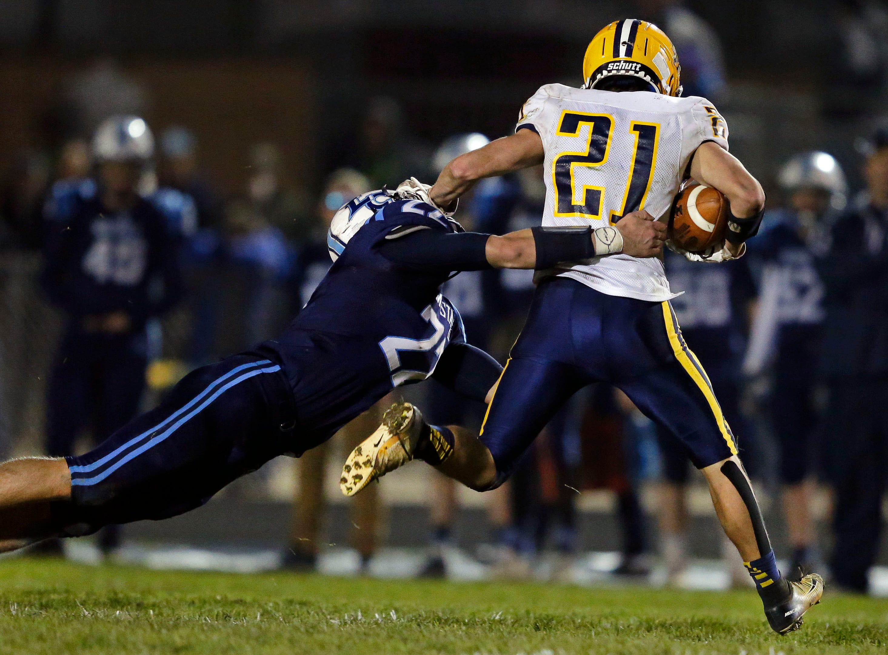 Bryce Schumacher of Little Chute tackles Gaven Lisowe of Chilton in a WIAA Division 4 second round football playoff game Friday, October 26, 2018, at Little Chute High School in Little Chute, Wis.Ron Page/USA TODAY NETWORK-Wisconsin