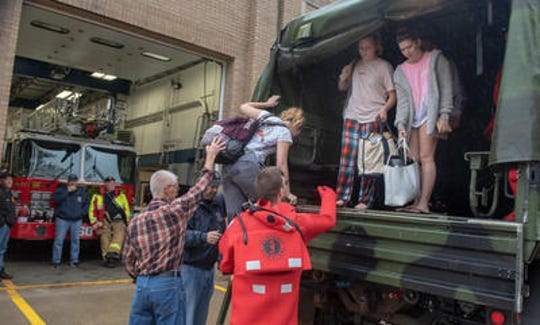 Giselle Scalzo, Port Monmouth, climbs down the truck at the Port Monmouth FD ahead of Abby Cimmino,, (plaid pants) Red Bank and Jessica Hirsch, Port Monmouth. Not pictured is Abby's brother Tyler Cimmino, Red Bank. A nor'easter storm brought heavy rain, wind and flooding to Monmouth County Saturday, October 27, 2018.