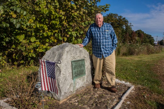 Historian Joseph Bilby at the Captain Samuel Allen memorial alongside Route 70 in Wall.