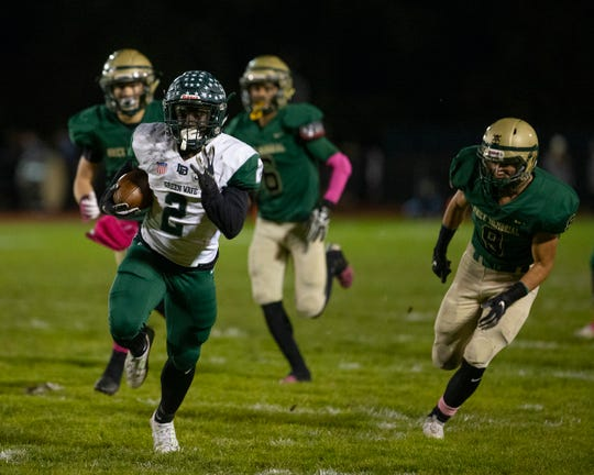 Long Branch's Jermaine Corbett runs long for his team's first touchdown of game. Long Branch football defeats Brick Memorial 40-14 in Brick NJ on October 26, 2018