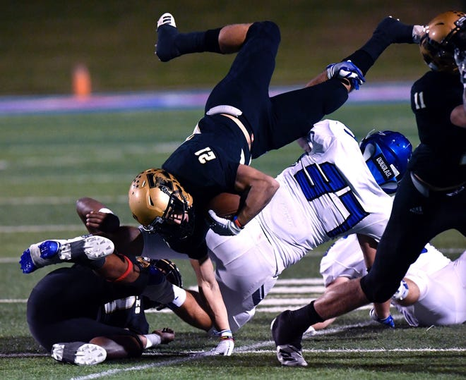 Abilene High wide receiver Reese Pettijohn dives over Weatherford linebacker Lucas Loran during football game at Shotwell Stadium on Friday, Oct. 26, 2018.
