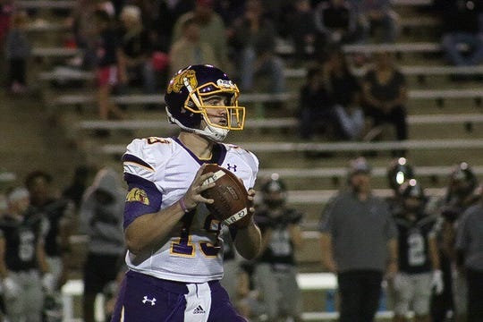 Wylie quarterback Harrison Atwood (19) looks to pass the ball during Friday's game at Canyon Randall. Atwood threw for two touchdowns and rushed for another in the 24-20 loss.