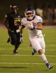 Cooper running back Noah Garcia runs for a 13-yard touchdown against Lubbock High.
