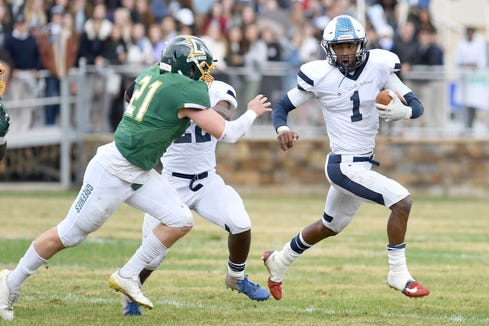 "Asheville School's Titus Morrision runs the ball against Christ School's Read Sunn in the 92nd meeting of ""The Game"" their annual rivalry on Oct. 27, 2018. The Greenies defeated the Blues 48-0."