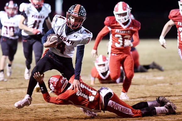 Pisgah's Devan Dodgin carries the ball as Franklin's Blake Gibson dives to stop him Oct. 26, 2018 in Franklin. Pisgah won, 21-14.