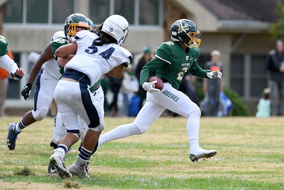 """Christ School's Kaedin Robinson runs the ball against Asheville School in the 92nd meeting of """"The Game"""" their annual rivalry on Oct. 27, 2018. The Greenies defeated the Blues 48-0."""