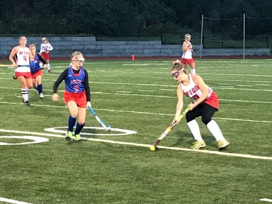 Afton's Taylor Schultz controls the ball as Owego's Jordan Greeno defends during Friday's Section 4 Class B title game at Greene. The Crimson Knights won, 11-0.