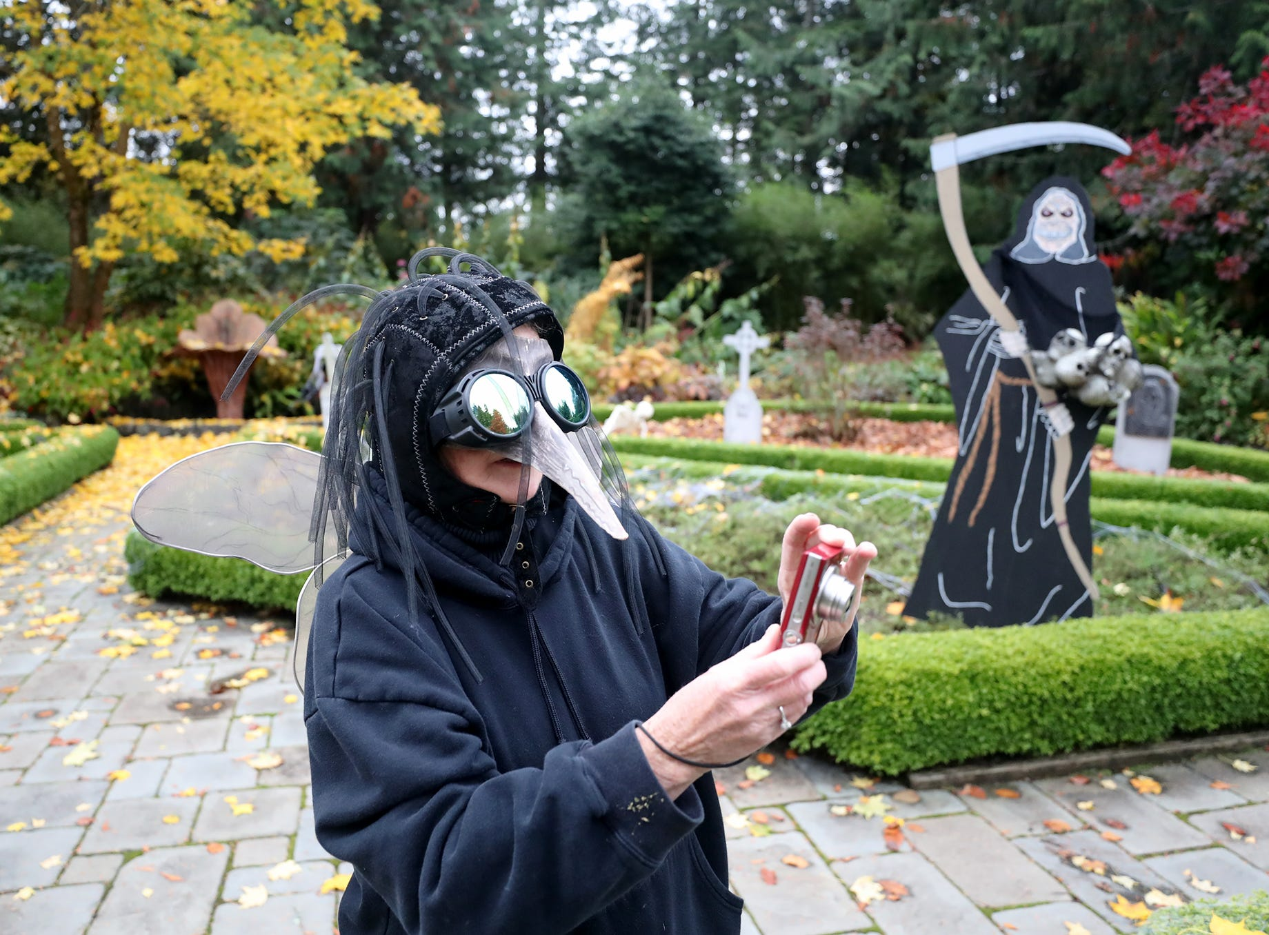 Neve Norton in her ugly garden bug costume takes photos before the opening at the Haunted Heronswood 2018 in Kingston was Friday and Saturday, October,26-27. The second annual garden halloween charters tour featured some SÕKlallam folk stories.