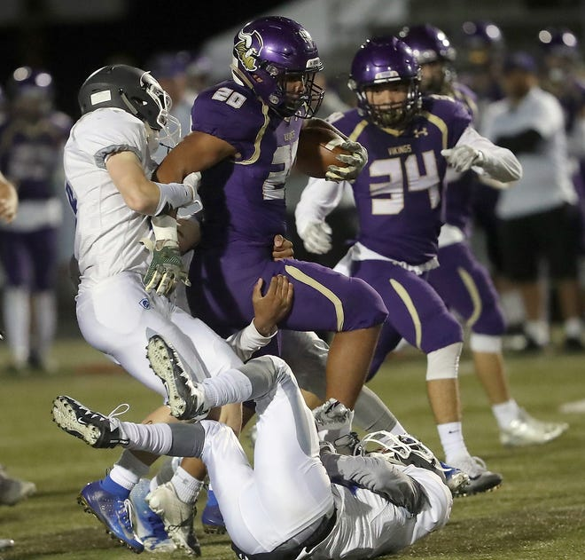 North Kitsap running back Isaiah Kahana fights off tackle attempts in the Vikings' Week 9 win over Olympic. North Kitsap takes on River Ridge in a Class 2A West Central District tournament game Friday at 7 p.m. in Poulsbo.