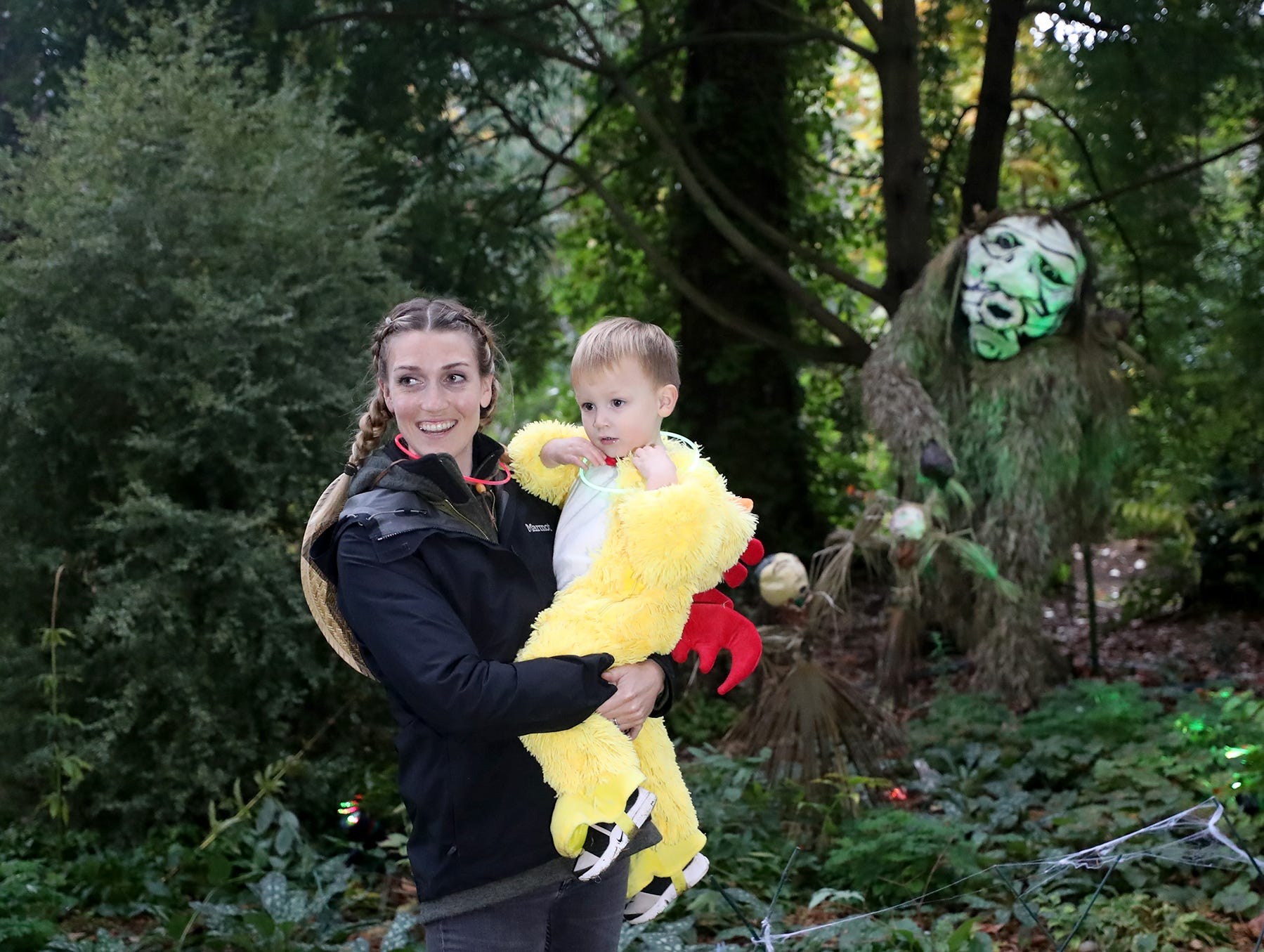 Mariah Ordonez and son Leo, 2, in front of Slapu at the Haunted Heronswood 2018 in Kingston was Friday and Saturday, October,26-27. The second annual garden halloween charters tour featured some SÕKlallam folk stories. She made the mask of Slapu which is from a S'Klallam story the mask.