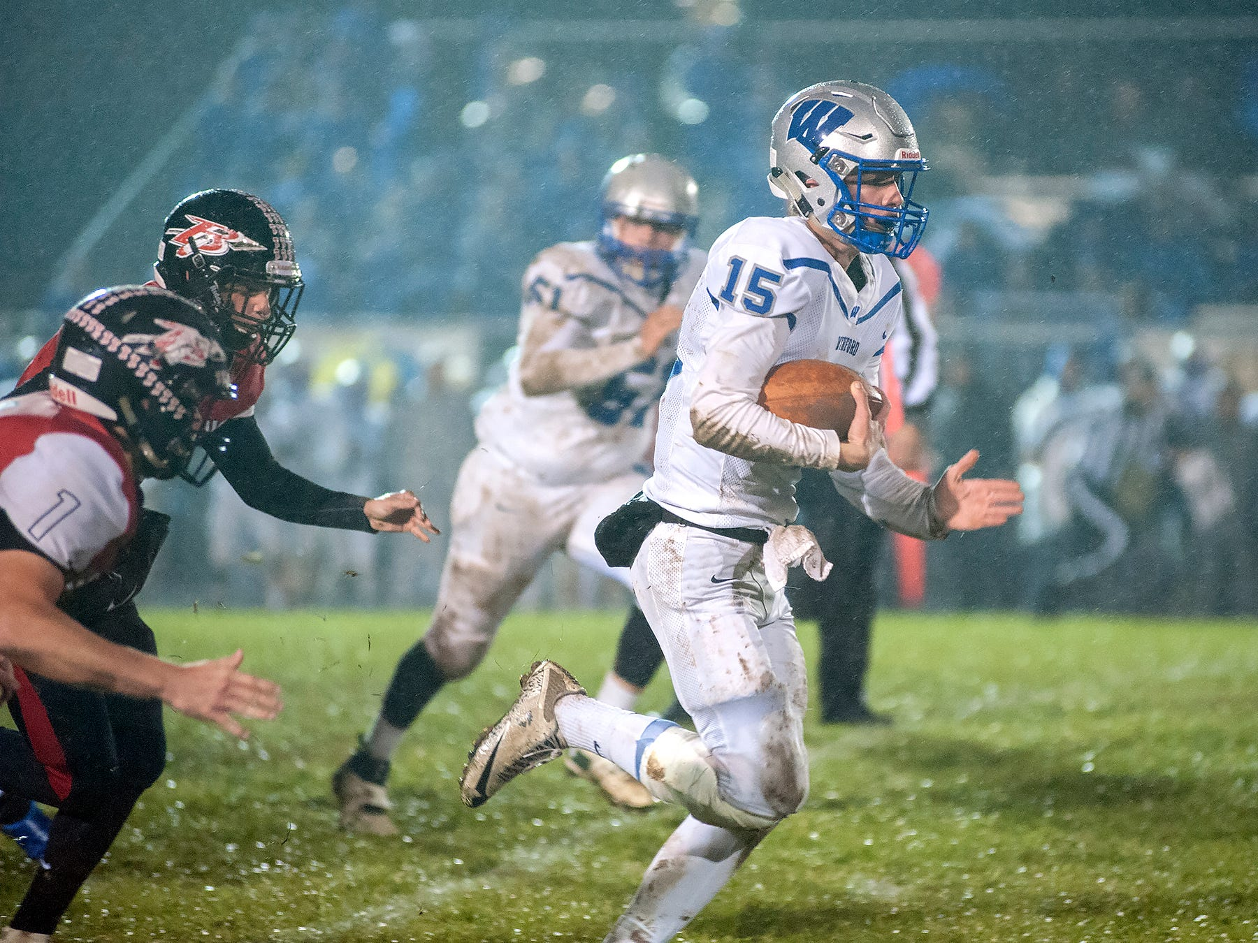 Wynford quarterback Dustin Brady scrambles with the ball.