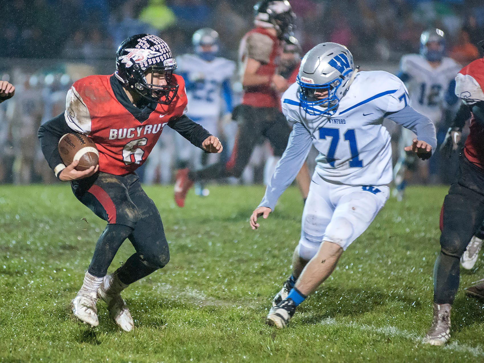 Bucyrus' Lincoln Mollenkopf tries to avoid Wynford's Zach Harer.