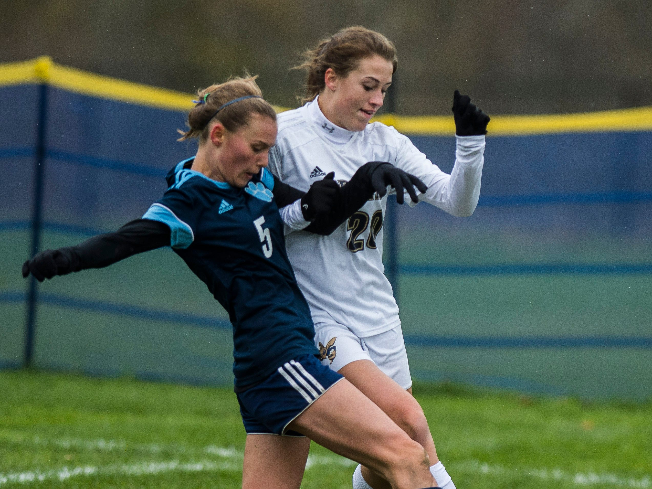 MMU #5 Skye Fitzhugh and Essex #22 Huntyr Poulin battle for the ball during their quarter-final game in Jericho on Saturday, Oct. 27, 2018, that went into double overtime and shootout. Essex took the penalty kick contest to win, 4-1.