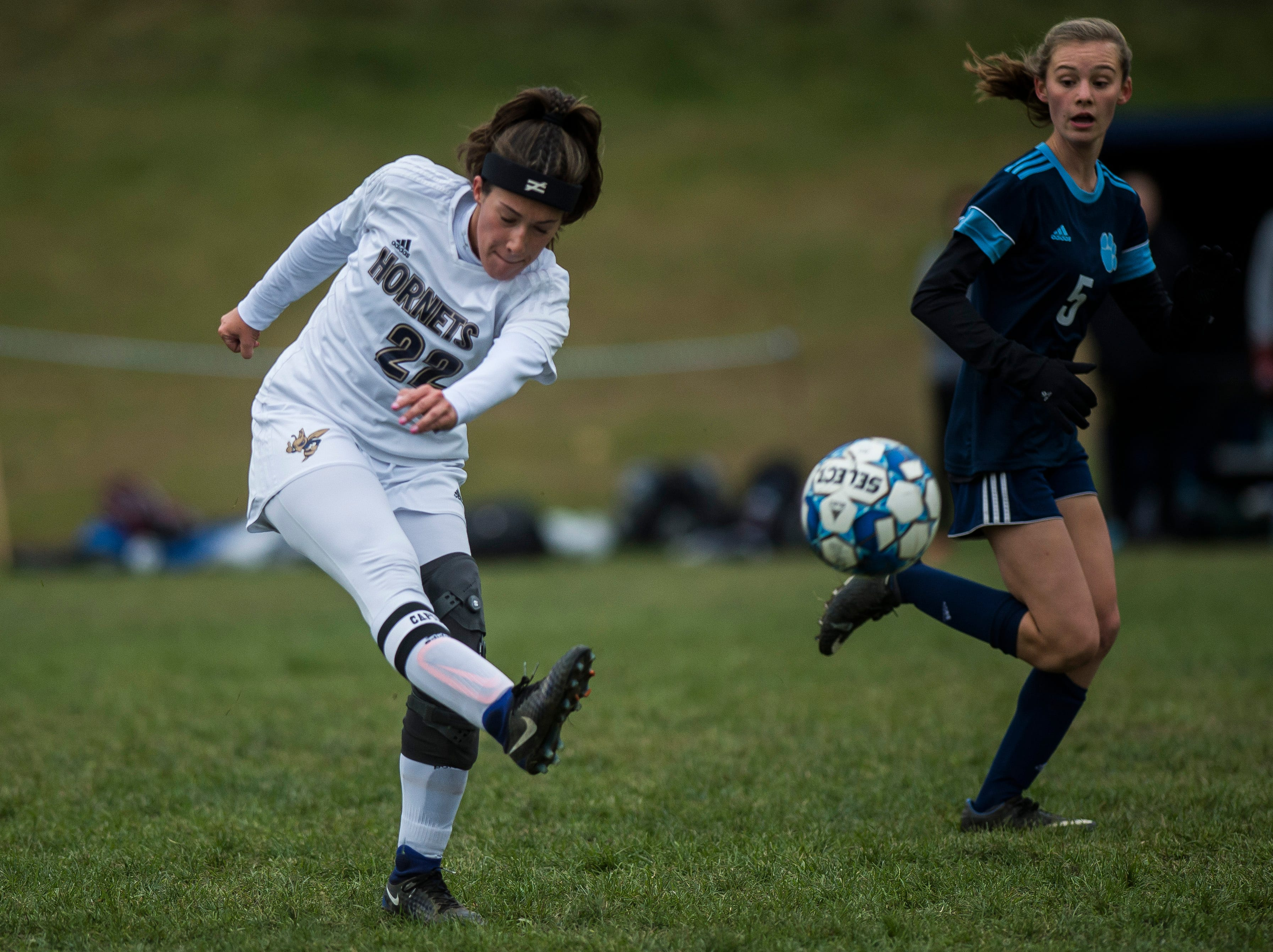 Essex #22 Huntyr Poulin breaks up an offensive push from MMU during their quarter-final game in Jericho on Saturday, Oct. 27, 2018, that went into double overtime and shootout. Essex took the penalty kick contest to win, 4-1.