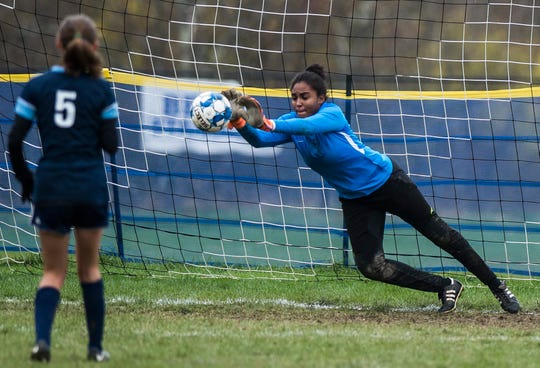 Essex goalie Yasmine Nsame saves MMU's second penalty kick from #5 Skye Fitzhugh during their quarter-final game in Jericho on Saturday, Oct. 27, 2018, that went into double overtime and shootout. Essex took the penalty kick contest to win, 4-1.