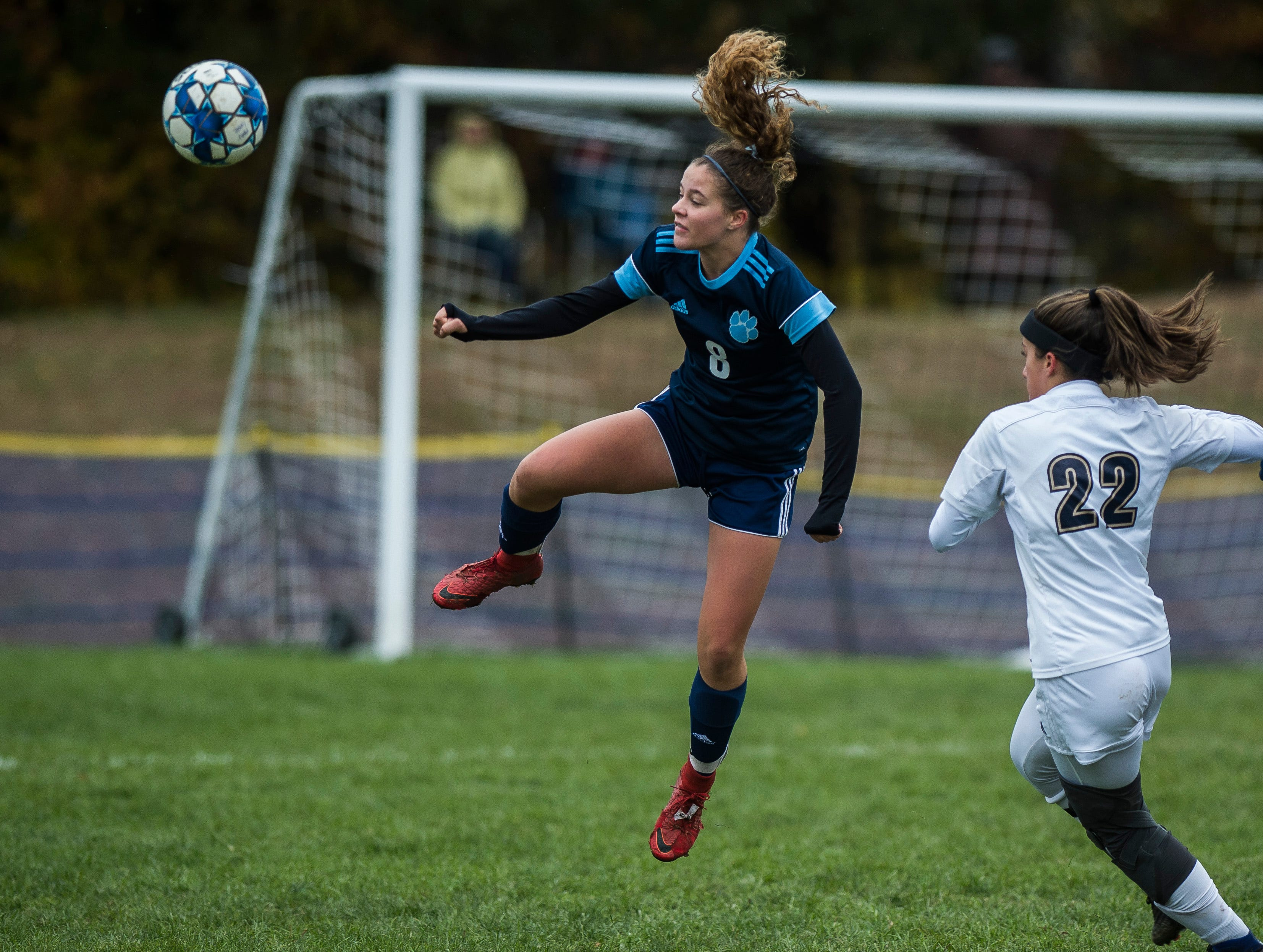 MMU #8 Taylor Bevins heads the ball back up field past Essex #22 Huntyr Poulin during their quarter-final game in Jericho on Saturday, Oct. 27, 2018, that went into double overtime and shootout. Essex took the penalty kick contest to win, 4-1.