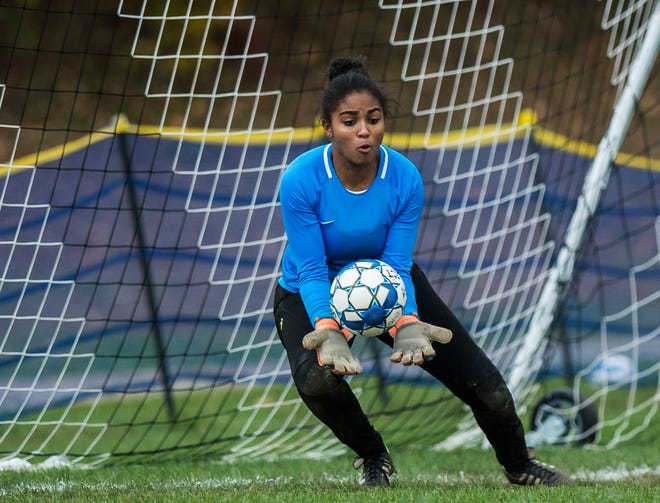 Essex goalie Yasmine Nsame saves a shot on goal during their quarter-final game in Jericho on Saturday, Oct. 27, 2018, that went into double overtime and shootout. Essex took the penalty kick contest to win, 4-1.
