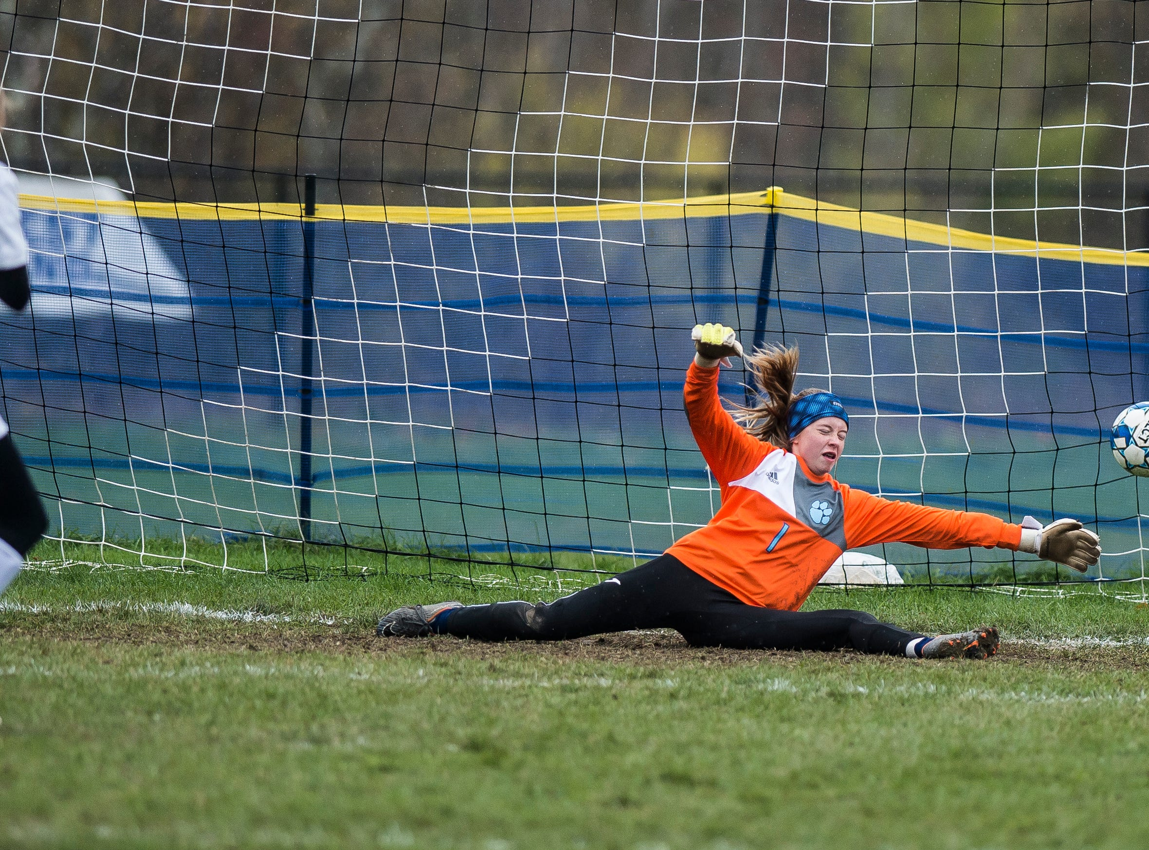 Essex #5 Natalie McMahon gets a fourth penalty kick past MMU goalie Anna Betz during their quarter-final game in Jericho on Saturday, Oct. 27, 2018, that went into double overtime and shootout. Essex took the penalty kick contest to win, 4-1.