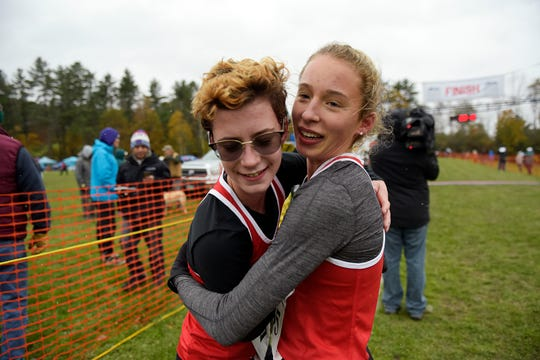 Champlain Valley's Alice Larson, facing, embraces teammate Ella Whitman after winning the Division I girls' cross country championship at Thetford Academy on Saturday, Oct. 27, 2018. Larson finished in a time of 19:29.3, Whitman was the runner up.