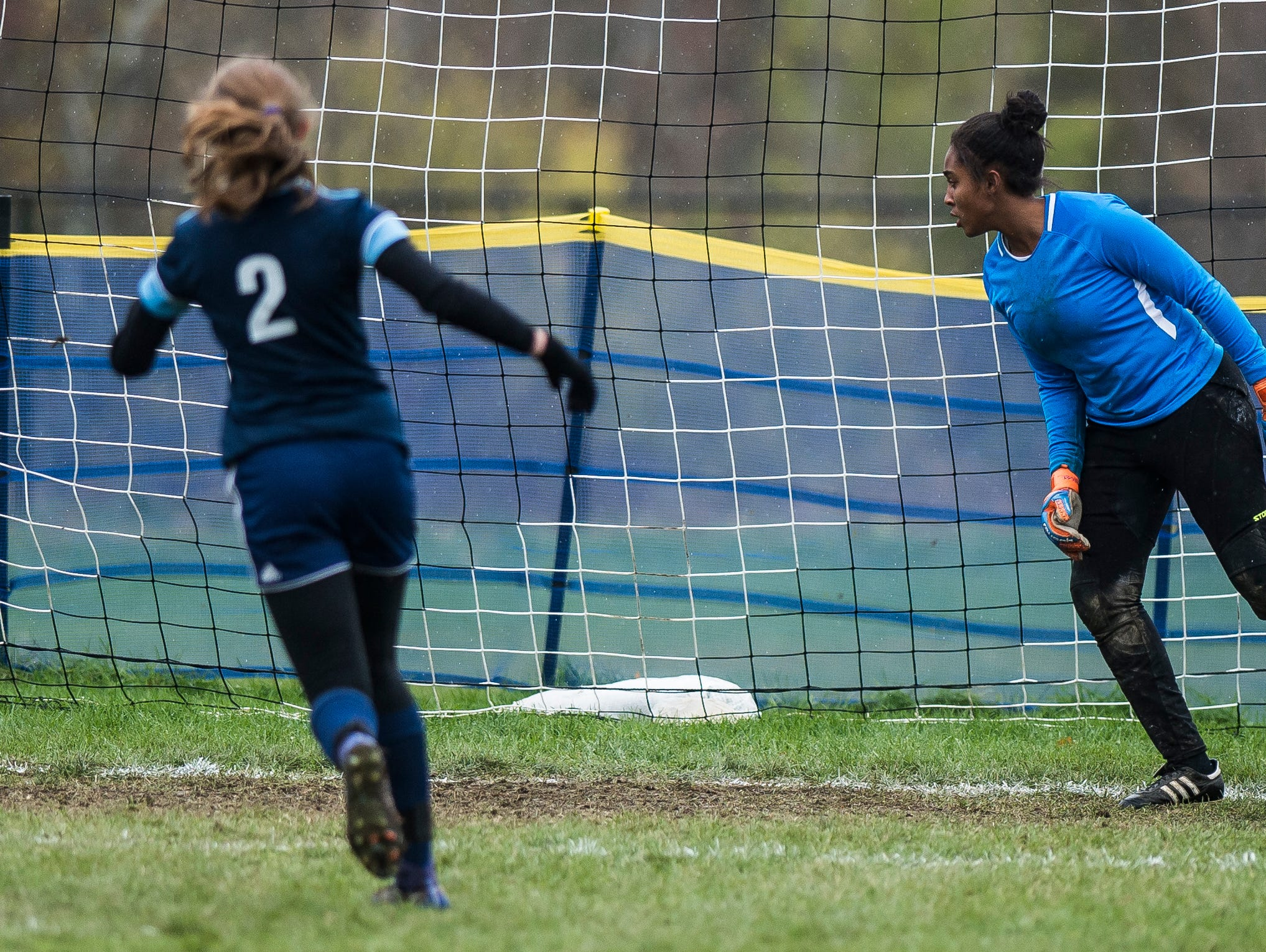 MMU #2 Sadie Gilbert-Barker scores on their third penalty kick attempt on Essex goalie Yasmine Nsame during their quarter-final game in Jericho on Saturday, Oct. 27, 2018, that went into double overtime and shootout. Essex took the penalty kick contest to win, 4-1.