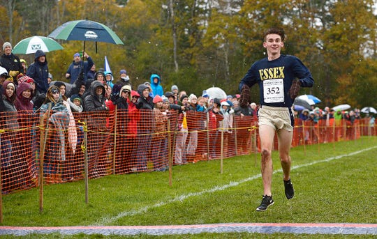 Essex junior Henry Farrington approaches the finish line, capturing the Division I boys crown on Saturday at Thetford.