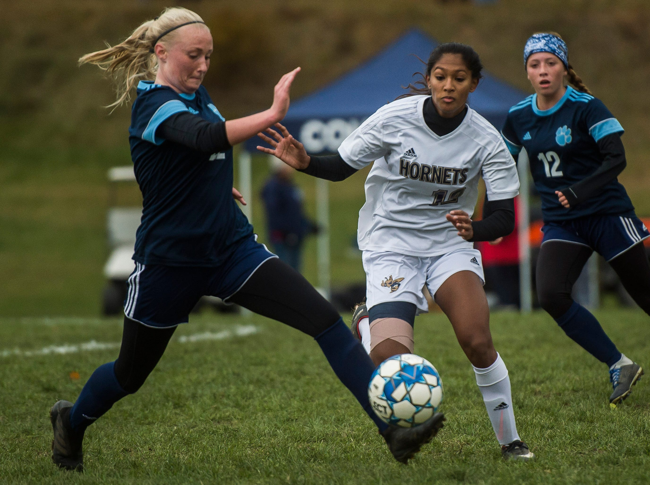 MMU #22 Willa Clark gets to the ball ahead of Essex #12 Souma Mitra during their quarter-final game in Jericho on Saturday, Oct. 27, 2018, that went into double overtime and shootout. Essex took the penalty kick contest to win, 4-1.