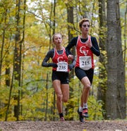 Champlain Valley sophomore Alice Larson, right, and senior Ella Whitman compete in the Division I girls' cross country championship at Thetford Academy on Saturday, Oct. 27, 2018. Larson and Whitman finished 1-2 as CVU captured the D-I team title.