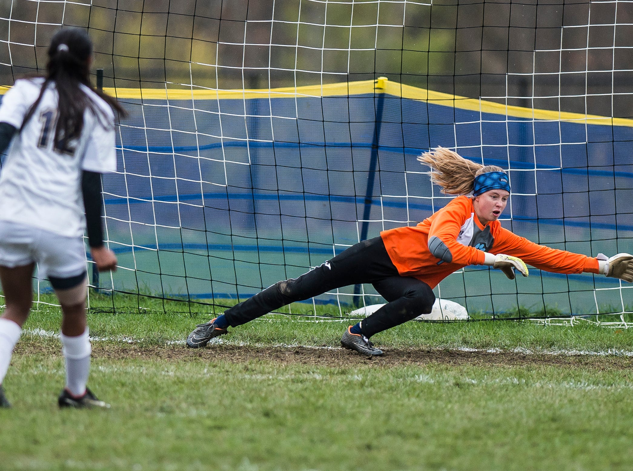 Essex #12 Souma Mitra gets a second penalty kick past MMU goalie Anna Betz during their quarter-final game in Jericho on Saturday, Oct. 27, 2018, that went into double overtime and shootout. Essex took the penalty kick contest to win, 4-1.