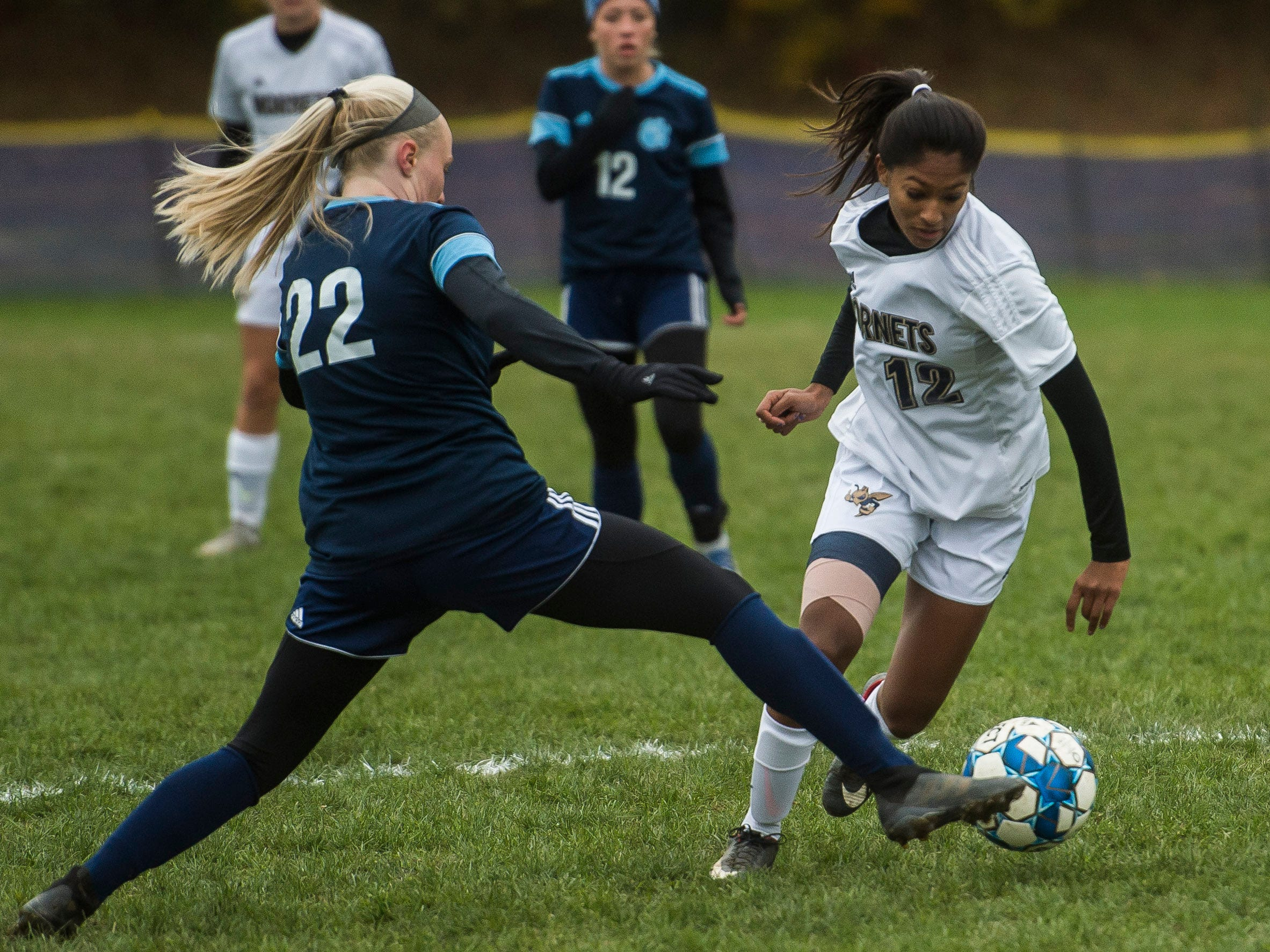 MMU #22 Willa Clark and Essex #12 Souma Mitra battle for the ball during their quarter-final game in Jericho on Saturday, Oct. 27, 2018, that went into double overtime and shootout. Essex took the penalty kick contest to win, 4-1.