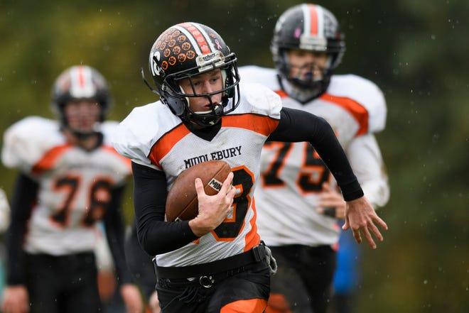 Middlebury quarterback Timothy Goettelmann (18) runs with the ball during the boys high school football game between the Middlebury Tigers and the Rice Green knights at Rice Memorial High School on Saturday afternoon October 27, 2018 in South Burlington.