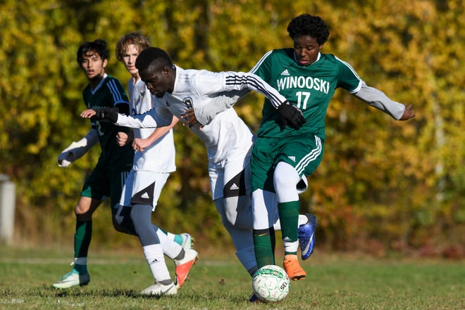 Winooski's Mowtes Ibrahim (17) battles for the ball with Vergennes' Josias Salomao (7) during the boys soccer quarterfinal game between Vergennes and Winooski at Winooski High School on Friday afternoon October 26, 2018 in Winooski.