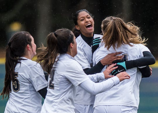 Essex girls soccer celebrates their quarter-final win over MMU in Jericho on Saturday, Oct. 27, 2018, that went into double overtime and shootout. Essex took the penalty kick contest, 4-1.