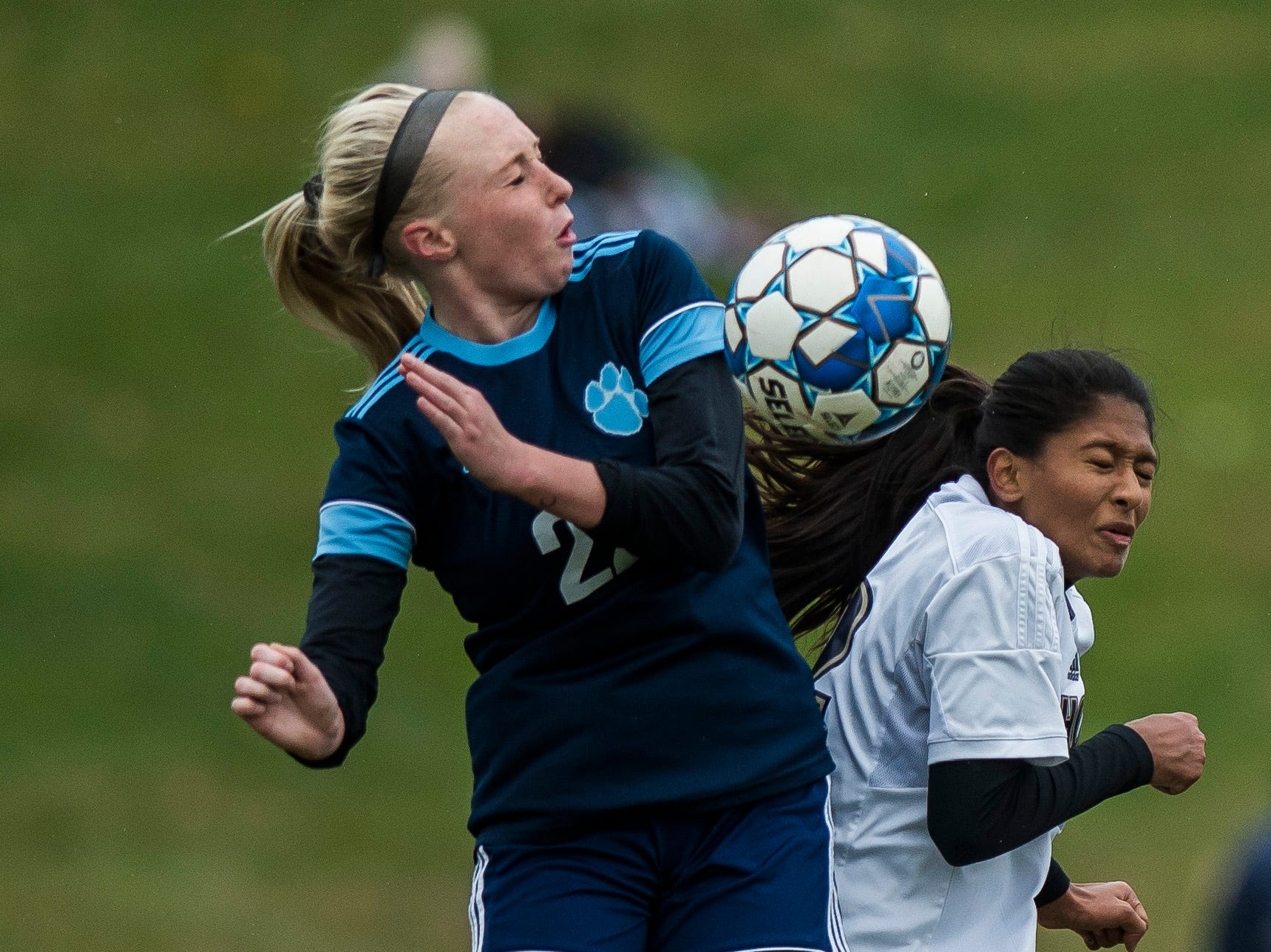 MMU #22 Willa Clark and Essex #12 Souma Mitra collide during their quarter-final game in Jericho on Saturday, Oct. 27, 2018, that went into double overtime and shootout. Essex took the penalty kick contest to win, 4-1.
