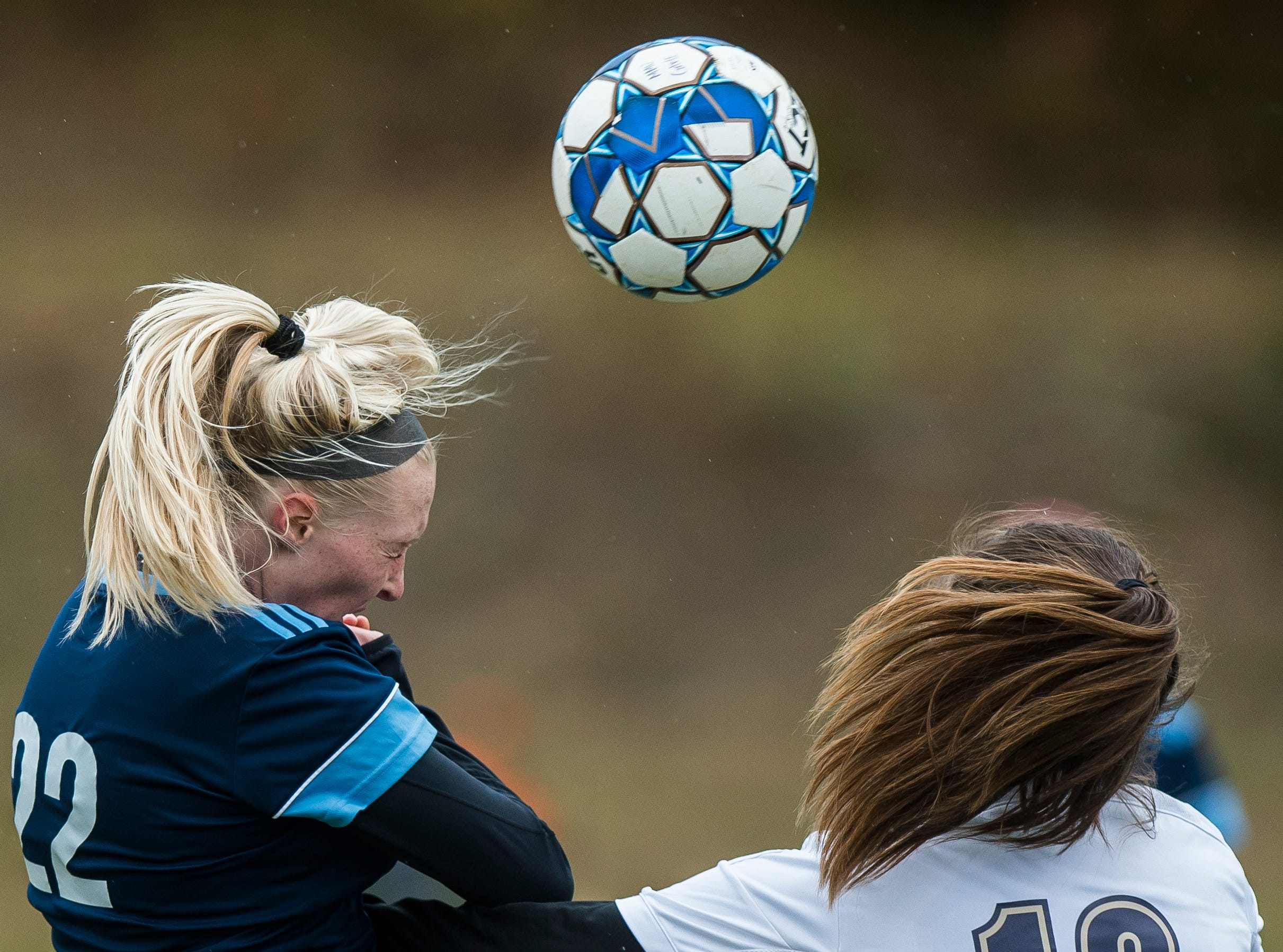 MMU #22 Willa Clark claims the header over Essex #18 Francesca Martin during their quarter-final game in Jericho on Saturday, Oct. 27, 2018, that went into double overtime and shootout. Essex took the penalty kick contest to win, 4-1.