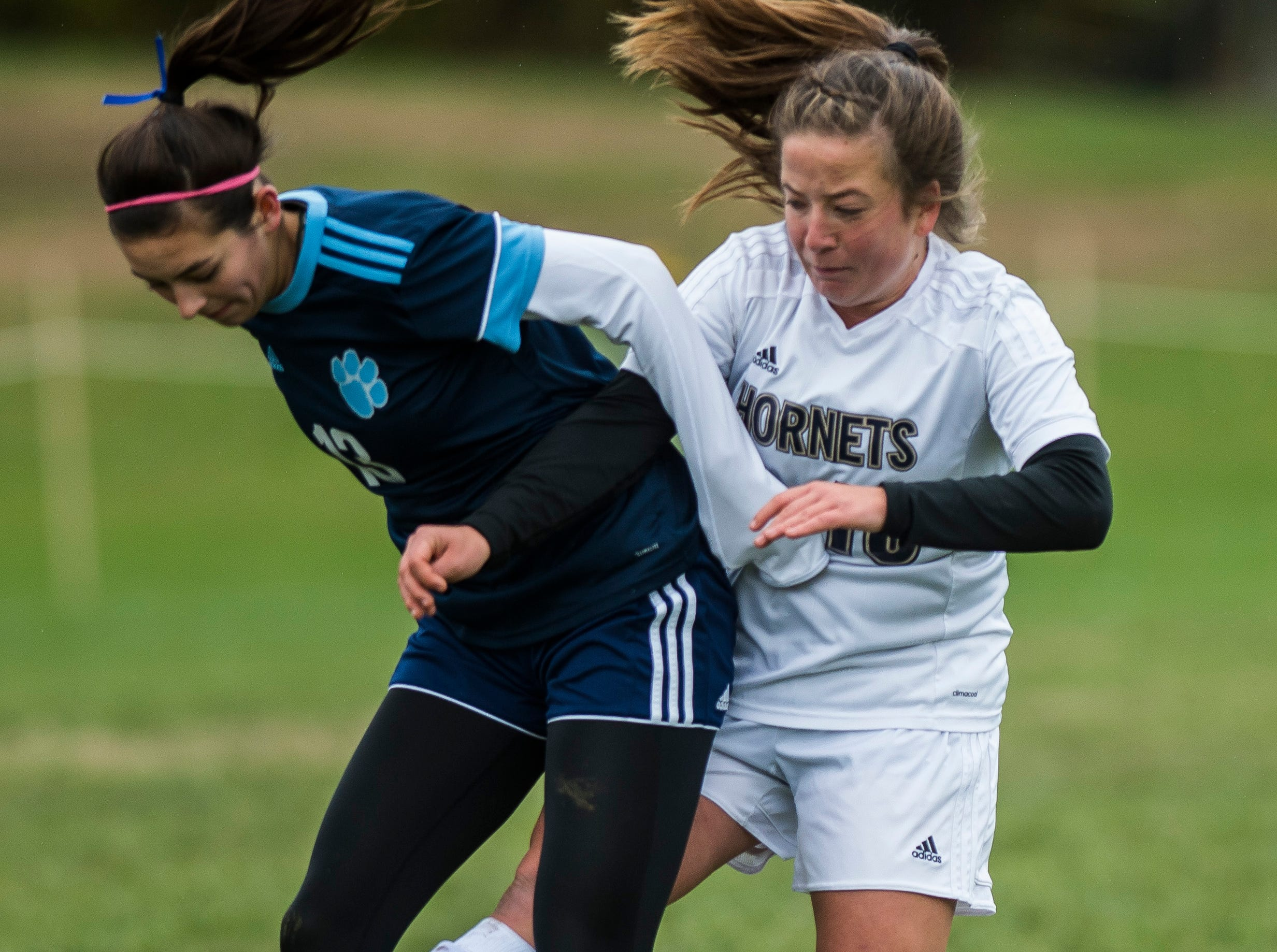 MMU #13 Macey Wissell and Essex #18 Francesca Martin fight for the ball during their quarter-final game in Jericho on Saturday, Oct. 27, 2018, that went into double overtime and shootout. Essex took the penalty kick contest to win, 4-1.